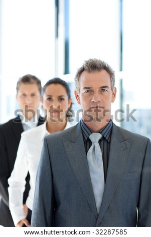 Senior businessman leading a business team in a row