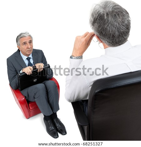 Senior businessman learning he is fired. - stock photo