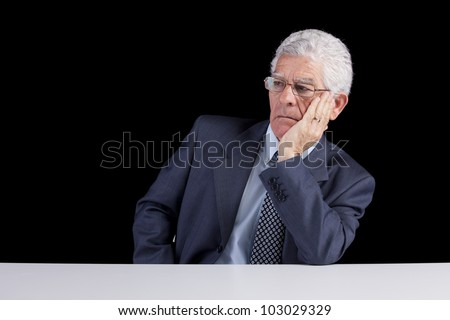 Senior businessman looking away to the copy space (isolated on black) - stock photo