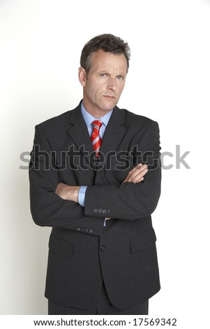 senior businessman looking concerned - stock photo