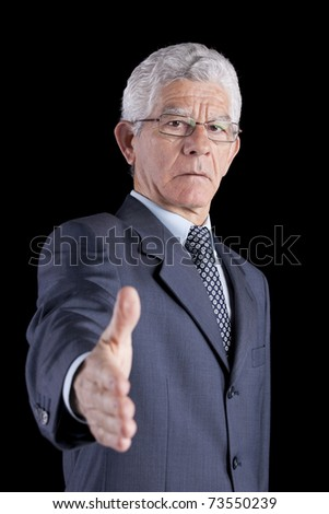 senior businessman making a deal with you (isolated on black) - stock photo