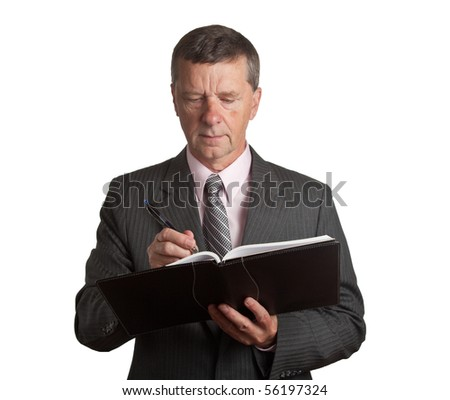 Senior businessman making a note in a black notebook - stock photo