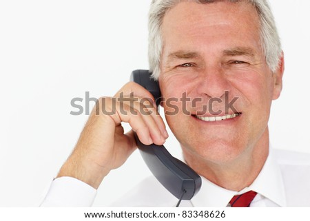Senior businessman on phone - stock photo
