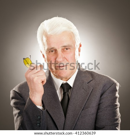 Senior businessman portrait with glasses isolated on grey