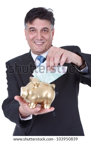 senior businessman putting money in piggy bank , isolated on white background - stock photo