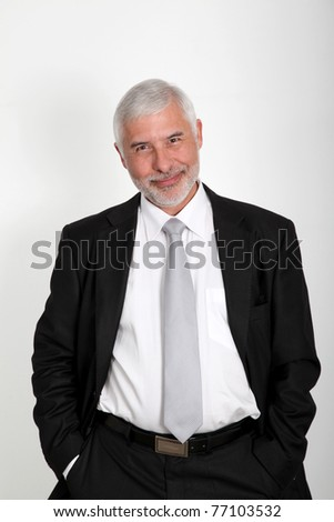 Senior businessman standing on white background - stock photo