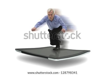 Senior businessman surfing on a PC tablet, symbol of speedy high technology - stock photo