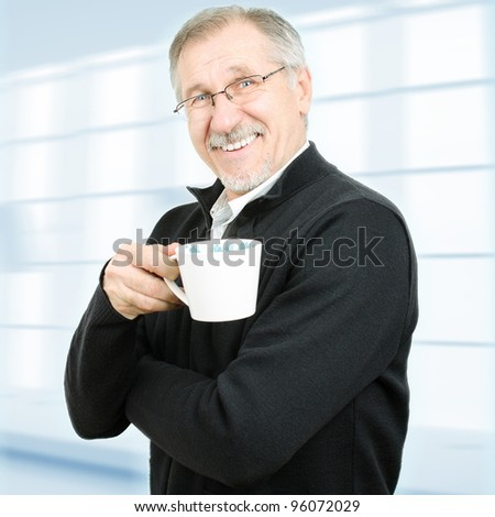 Senior businessman taking a break. Isolated with clipping path. - stock photo