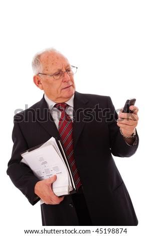 senior businessman talking on his cellular (isolated on white) - stock photo