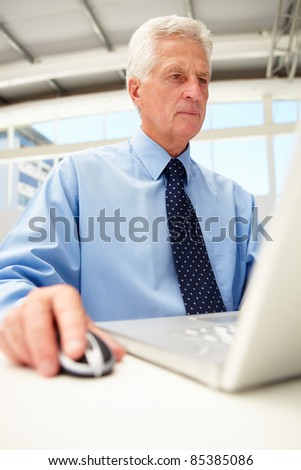 Senior businessman using laptop