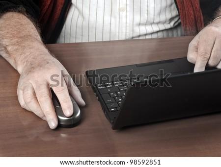 Senior businessman using laptop - stock photo