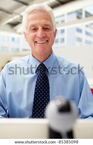 Senior businessman using skype - stock photo