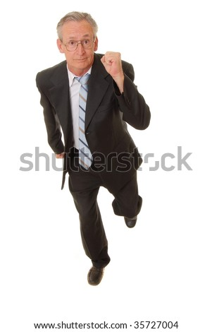 Senior businessman wearing suit running isolated over white - stock photo