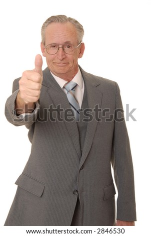 Senior businessman with a rather interesting expression and thumbs up
