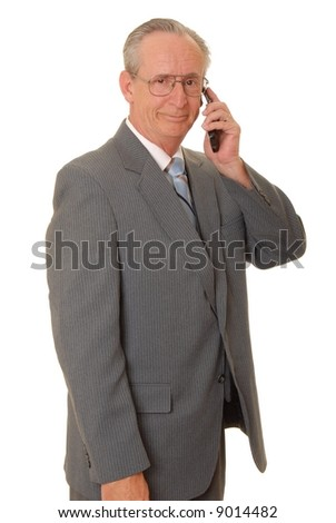 Senior businessman with a rather interesting expression listening on a cellular telephone - stock photo