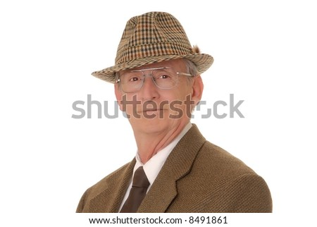 Senior businessman with a rather interesting expression wearing a hat - stock photo