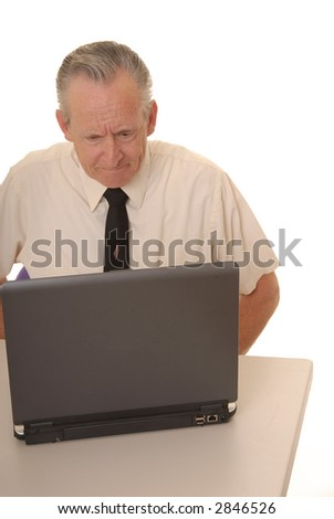 Senior businessman with a rather interesting expression working on a laptop computer