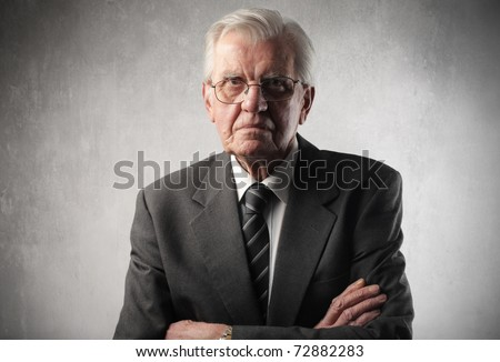 Senior businessman with angry expression - stock photo