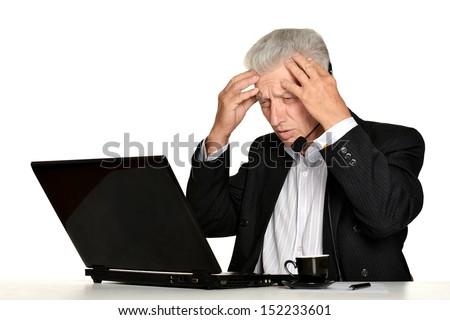 Senior businessman with laptop on white background - stock photo