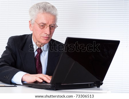 senior businessman with laptop on white background