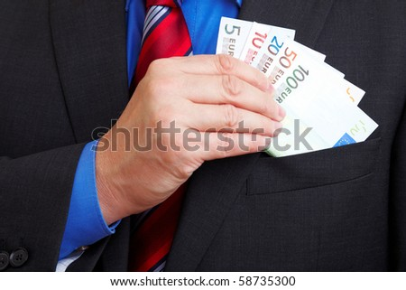 Senior businessman with many Euro banknotes in his pocket