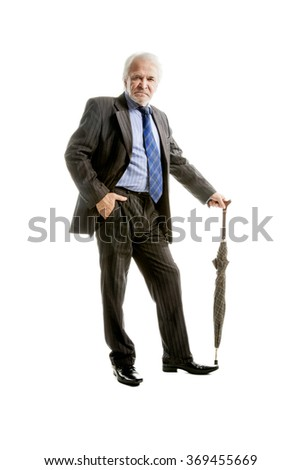Senior businessman with umbrella  isolated over white background