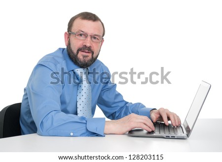 senior businessman working on laptop - stock photo