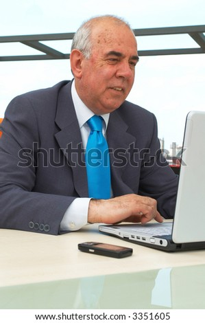 senior businessman working with a modern laptop