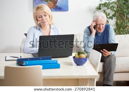 Senior businesspeople during their work at home - stock photo
