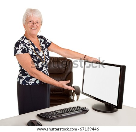 Senior Businesswoman Pointing at her Monitor - stock photo