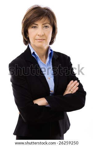 Senior businesswoman standing arms crossed, isolated on white background. - stock photo