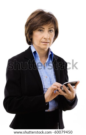 Senior businesswoman using mobile phone, writing email or text message. Isolated on white background. - stock photo