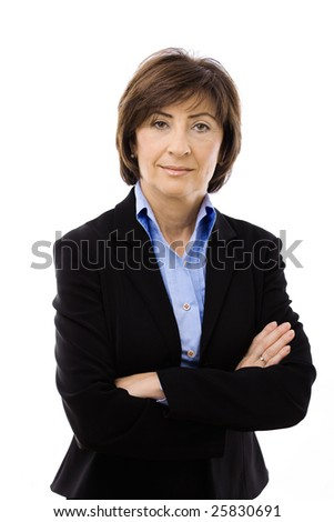Senior businesswoman wearing black suit posing with crossed arms, isolated on white background. - stock photo