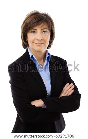 Senior businesswoman wearing black suit posing with crossed arms, isolated on white background.? - stock photo