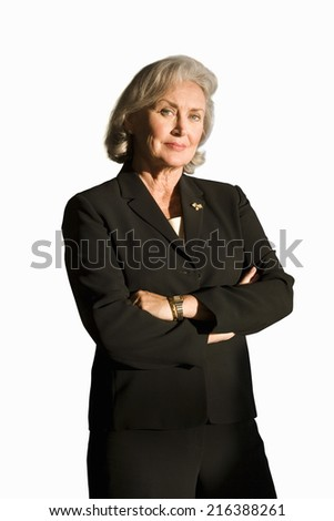 Senior businesswoman with arms folded, smiling, portrait, cut out - stock photo