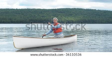 Senior canoe paddler - stock photo