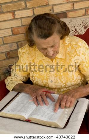 senior caucasian female reading the Bible - stock photo