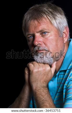 Senior caucasian man with blue shirt - stock photo