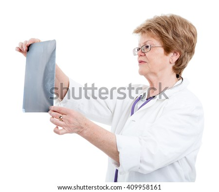 Senior Caucasian woman a doctor looking an X-ray picture, isolated on white background