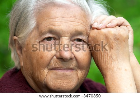 Senior cheerful woman looking away, portrait - stock photo