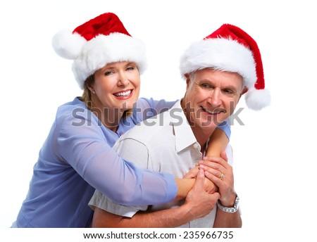 Senior Christmas santa couple isolated over white background - stock photo
