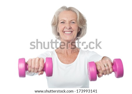 Senior citizen doing exercise with dumbbells - stock photo