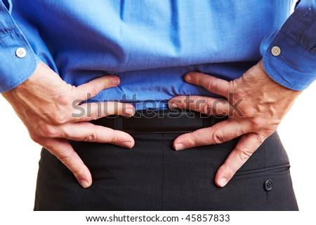 Senior citizen holding his hands on his aching back - stock photo