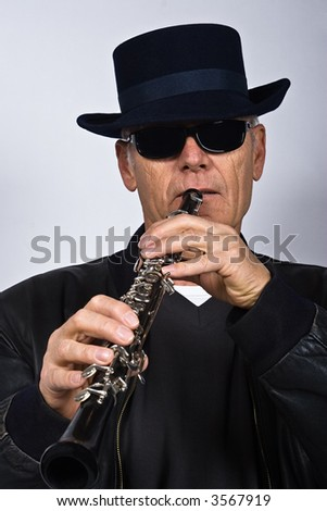 senior citizen playing the clarinet, jazz, people diversity series
