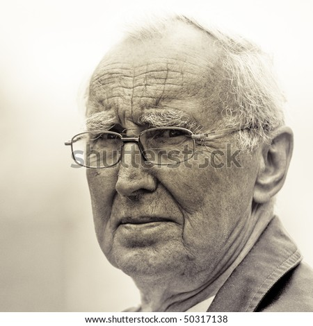 Senior citizen with serious expression, black and white tone - stock photo
