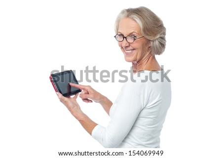 Senior citizen working on new tablet pc
