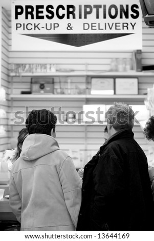 Senior citizens in the line to pick up prescriptions in the pharmacy - stock photo