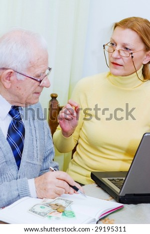 Senior client talking with woman agent - stock photo