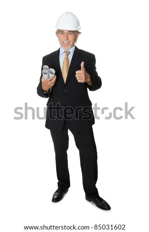 Senior construction worker giving thumbs up - stock photo