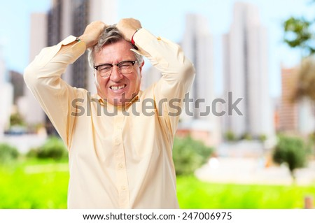senior cool man angry face - stock photo